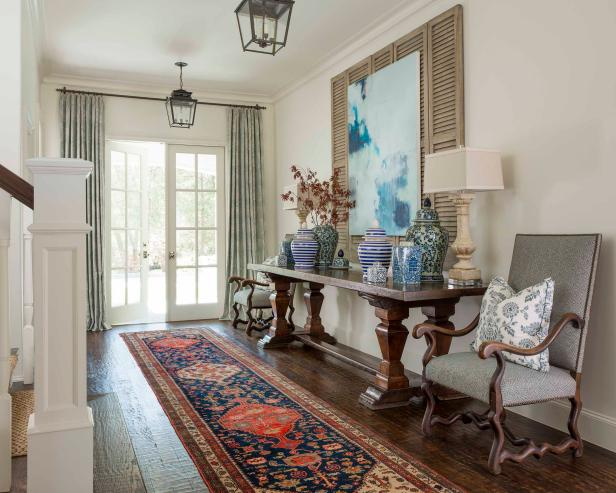 White French Door Access to Traditional Foyer With Gray Upholstered Chairs, Patterned Carpet Runner and Lantern Pendant Lights