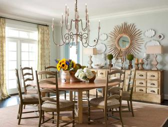 Shabby Chic Dining Room With Mint Green Walls, Vintage Chandelier and Round Wood Dining Table
