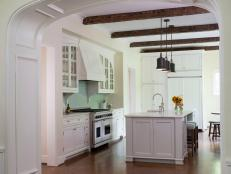 White Cottage Kitchen With Arched Entrance