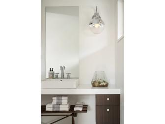White Powder Room Vanity With Globe Sconce