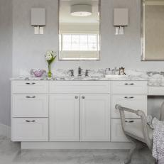White Bathroom With Marble Backsplash and Floor