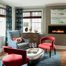 Blue and Brown Midcentury Sitting Room With Red Chairs