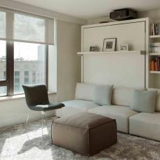 Media Room Triples as Office and Guest Bedroom with Stylish Murphy Bed