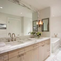 Master Bathroom with Sycamore Cabinets and Dramatic Marble Accents