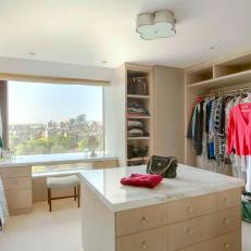 Custom-Built Walk-In Closet with Sycamore Cabinets and Calcutta Marble