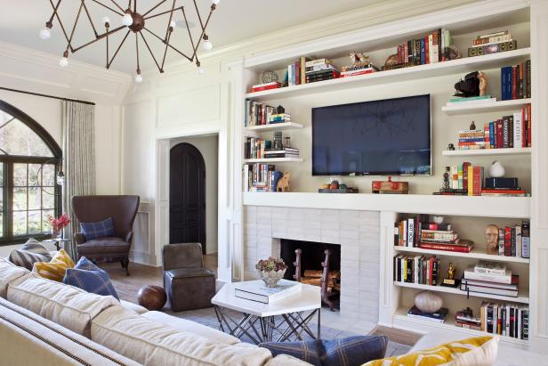 Cozy Living Room With Built-in Bookshelves and Fireplace