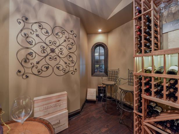 Wine Cellar With Wooden Bottle Racks, Wrought Iron Wall Art and Wood Wine Boxes for Decor