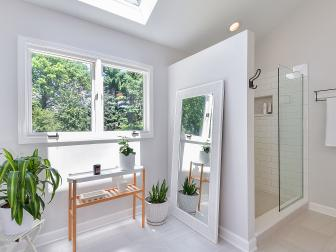 Skylight Brightening Monochromatic Contemporary Bathroom With Subway Tile Shower and Floor Full Length Mirror
