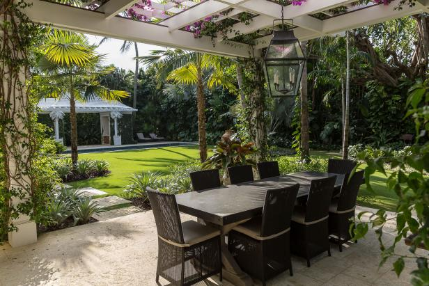 Add a light fixture over an outdoor dining area, whether it's completely covered or underneath a pergola. Nievera Williams Design designed the pergola, which is covered in low water bougainvillea, in this Palm Beach, Fla., yard that won a Florida chapter of the American Society of Landscape Architects award.