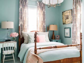 Calming Gray-Green Color Scheme in Country Bedroom With Wood Bed Frame, Patterned Curtains and Smooth Flooring