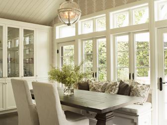 Neutral Cottage Breakfast Room With Vaulted Ceiling
