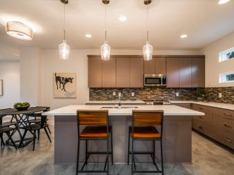 Warm and Inviting Eat-In Kitchen With Polished Concrete Floors