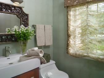 Traditional Powder Room With Floral Roman Shades