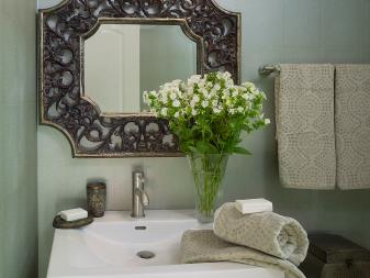 Traditional Powder Room With Ornate Vanity Mirror