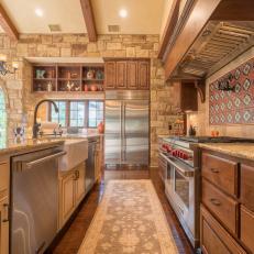 Neutral Stone Mediterranean Kitchen With Dual Dishwashers