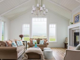 Transitional Living Room With Large Windows and White Vaulted Ceiling