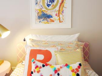 Gray Girl's Bedroom With Framed Finger Painting and Colorful Twin Bed