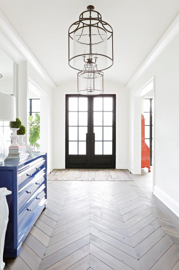 White Contemporary Foyer With Chevron Floor