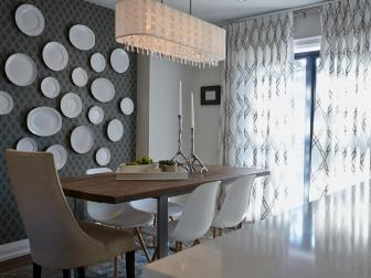 Artistic Midcentury Modern Dining Room With Wallpaper Plate Wall and Tall-Back Head Dining Chair