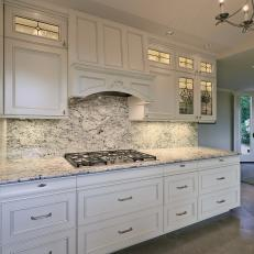 Light Airy Kitchen With Leaded Glass Front Cabinets And Under Cabinet  Lighting
