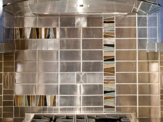 Modern Kitchen with Silver and Glass Hood Vent and Silver, Brown and Green Colored Tiles