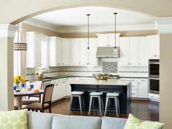 Transitional White and Black Kitchen with Pops of Blue and Archway