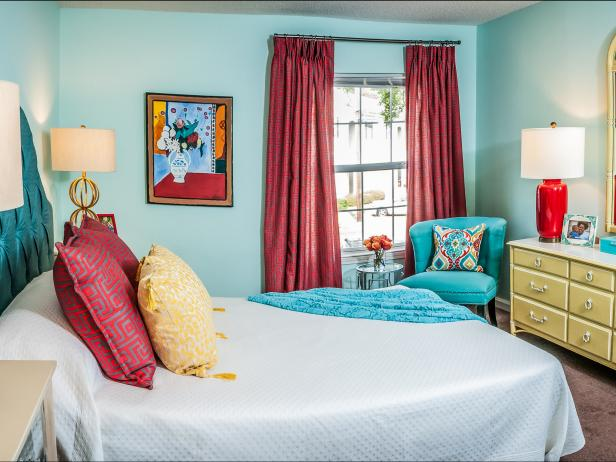 After: Master Bedroom with Plush Headboard and Bright Colors