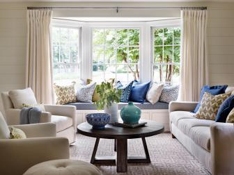 Bright Living Room With Built-In Window Seat and Blue Accents