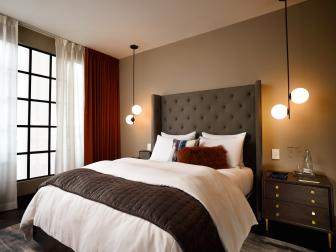 Modern Guest Room with Globe Pendants and Tufted Headboard