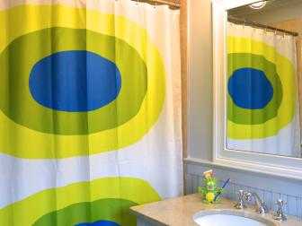 Brightly Colored Geometric Shower Curtain in Kids' Bathroom