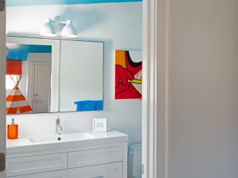 Whimsical Blue and Orange Kids' Bathroom