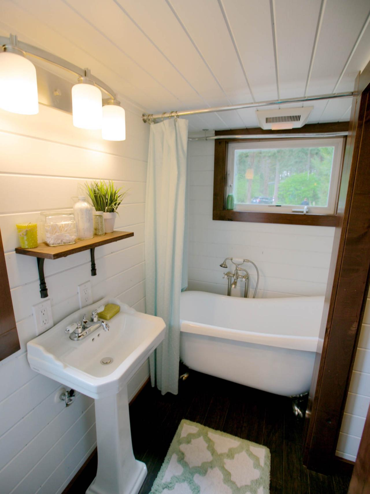 8 tiny house bathrooms packed with style hgtv 39 s for Tiny bathroom decor