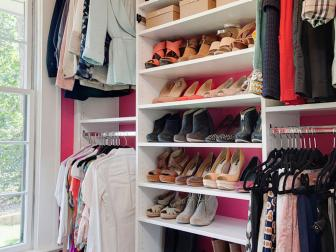 Pink and White Walk-In Closet With Shoes