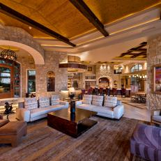 Open, Contemporary Living Room With Stone Walls
