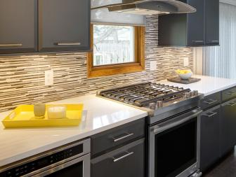 Gray and Black Modern Kitchen With Yellow Tray