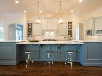 Blue and White Open Plan Kitchen With Metal Stools