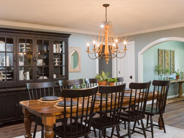 Simply Elegant Country Dining Room With Large Wood China Cabinet, Long Dining Table and Beaded Chandelier