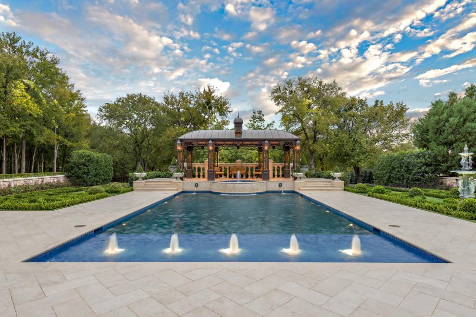 Elegant backyard includes custom cabana and formal gardens for Garden training pool