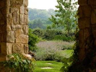 Rustic Stone Archway Leads to Formal Garden