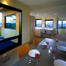 Modern Dining Room Featuring Stainless Steel Dining Table And Gorgeous  Mountain Views