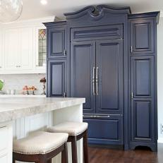Awesome Rich Navy Blue Cabinet In Bright Kitchen With Hardwood Floor And  Upholstered Barstools