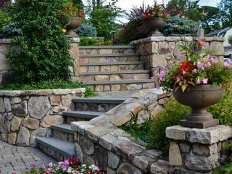 Custom Stone Stairs Lead to Backyard