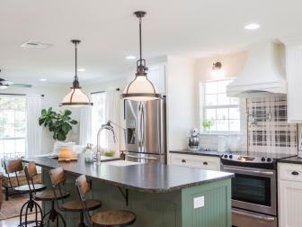 Contemporary White Kitchen with Green Island and Black Countertops