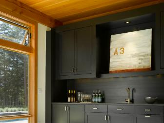 Charming Kitchenette With Dark Cabinetry