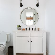 Single Vanity Bathroom With Two Black Sconces