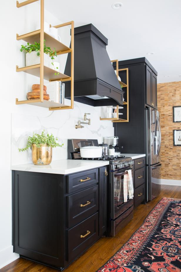 Contemporary Black and White Kitchen with White Granite Countertops and Backsplash