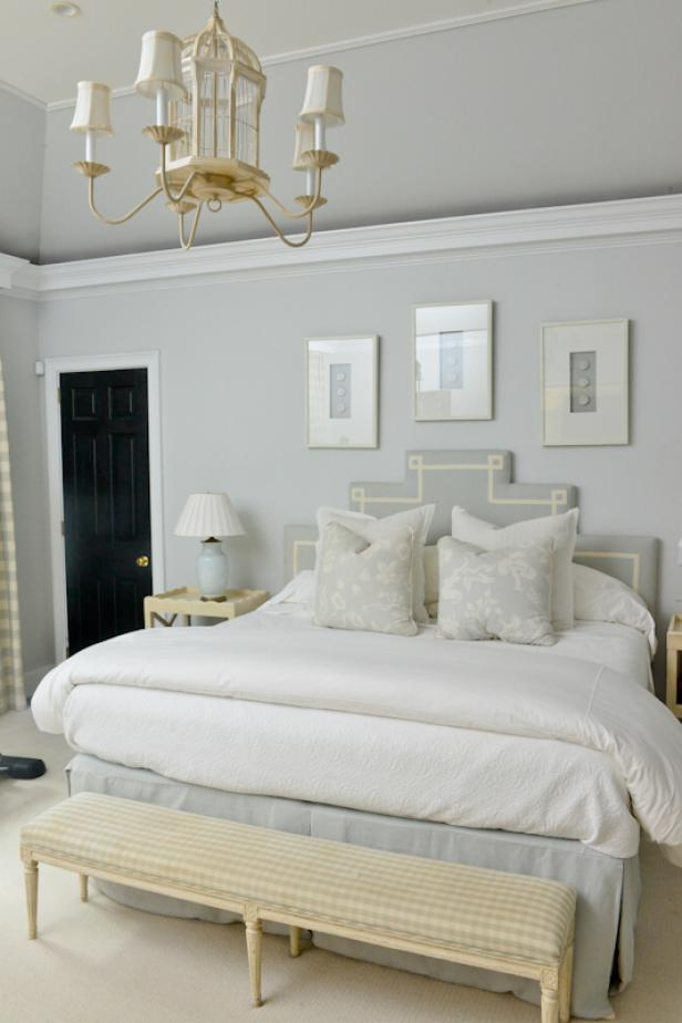 Traditional Gray and White Bedroom with 18-Foot Ceilings, Custom Headboard, White Comforter, Footboard Bench and Accent Door