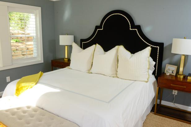 Traditional Navy and Yellow Master Bedroom with Upholstered Headboard, Nightstands and Lamps