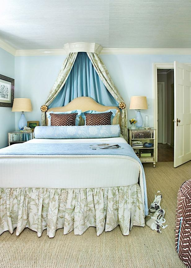 Blue and Green Master Bedroom with Floral Accents, Woven Rug and Canopy