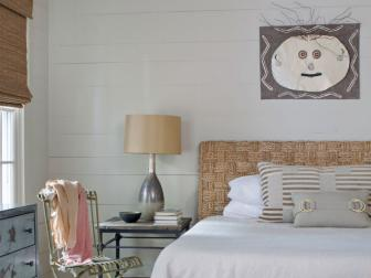 Neutral Transitional Guest Bedroom With Folk Art